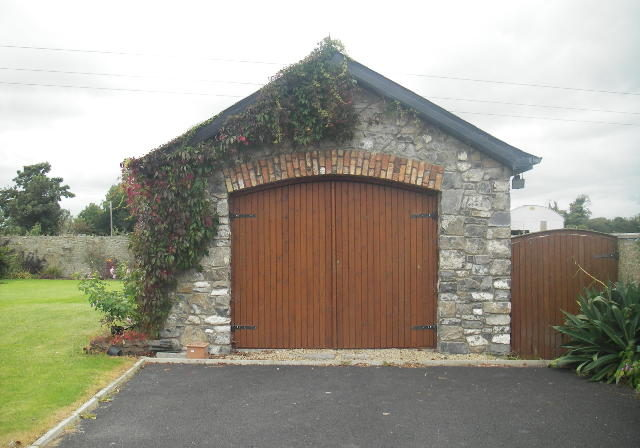 Garage with limestone front and brick arch