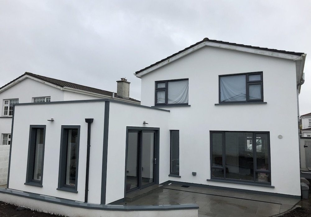 Contemporary style extension with parapet flat roof and anthracite windows/doors