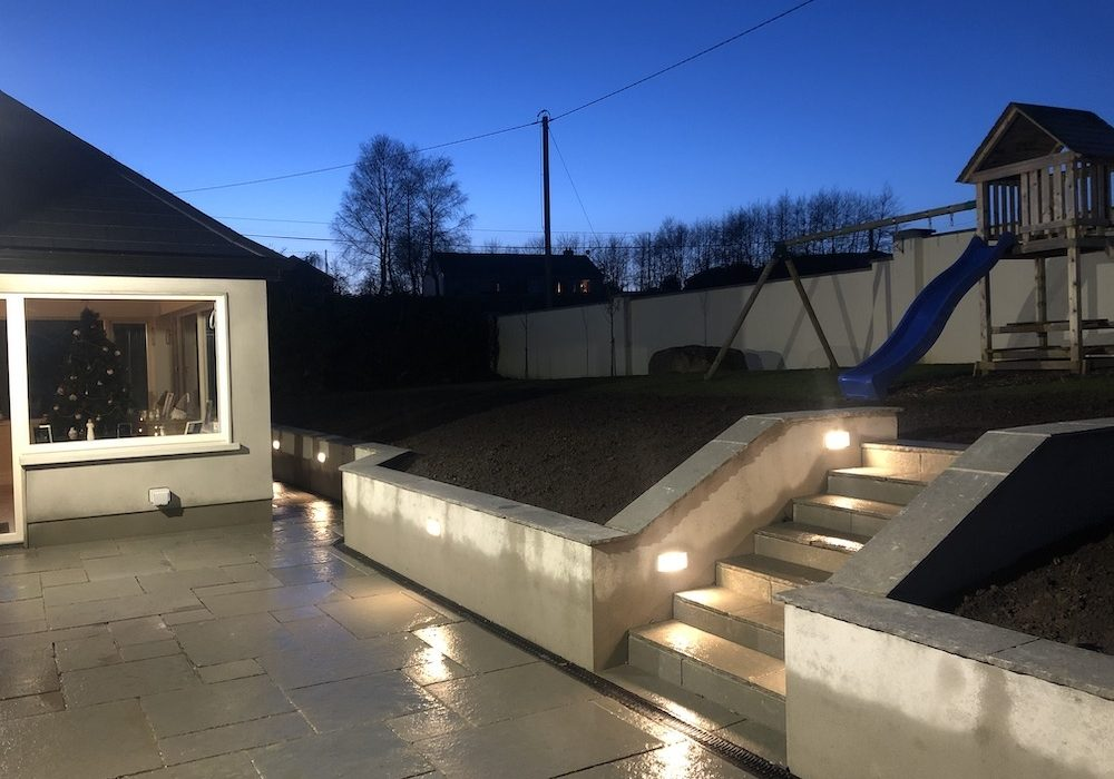 Mint Limestone with retaining wall and raised steps with aco-drains
